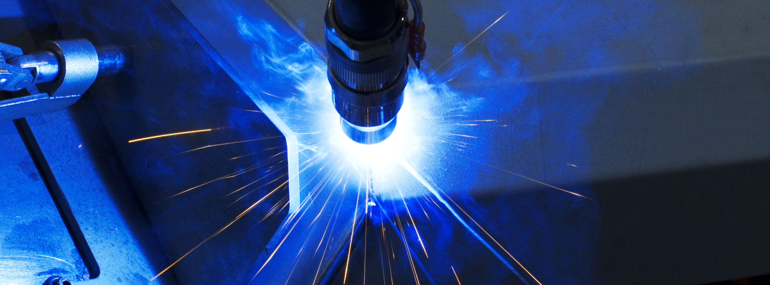 Welding robot shot with great sparks